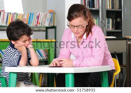 Teacher and preschooler. - stock photo