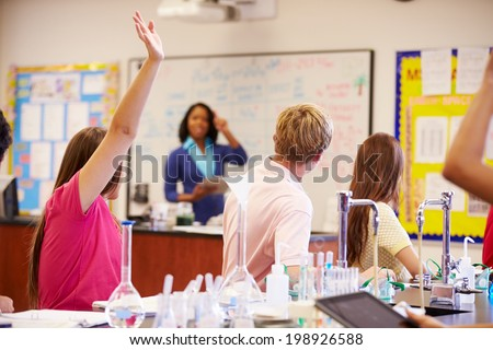 Teacher And Pupils In High School Science Class - stock photo