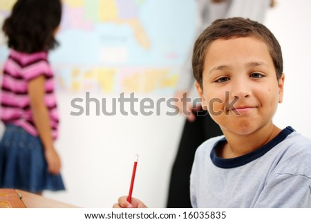 Teacher and Students In A Classroom At School - stock photo