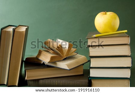 Teacher Day (still life with books, blackboard and apple) - stock photo