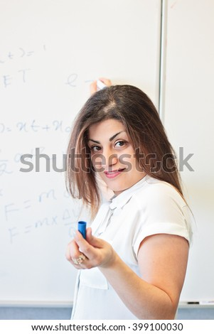 Teacher explain standing near the board - stock photo