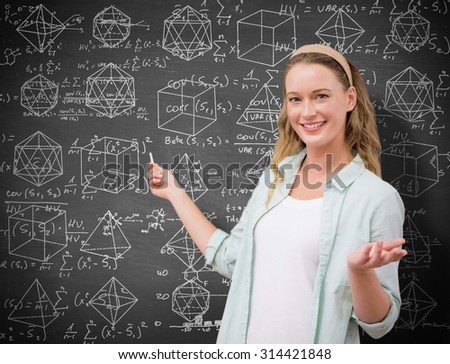 Teacher explaining maths in blackboard against black background - stock photo
