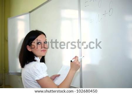 teacher explains the next board lessons - stock photo