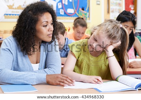 Teacher Female Elementary School Pupil With Problem