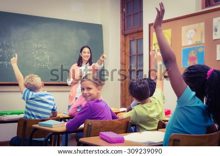 Teacher gettting an answer from a student at the elementary school
