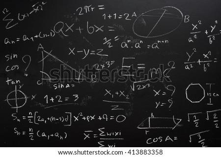Teacher Hand drawn mathematics on chalkboard. - stock photo