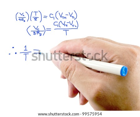Teacher hand writing a mathematical equation on a white screen. - stock photo