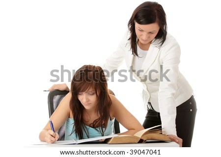 Teacher Helping teen Student One on One. Shot in studio over white. - stock photo