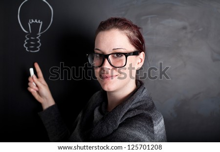 Teacher in front of a chalkboard