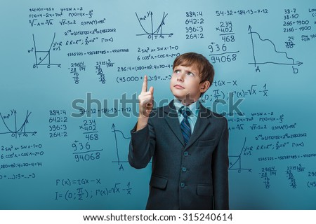 Teacher learned professor teenager boy shows a finger portrait science mathematical formulas math problem Infographics photo studio - stock photo