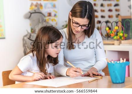 Teacher Mom working with Creative Kid