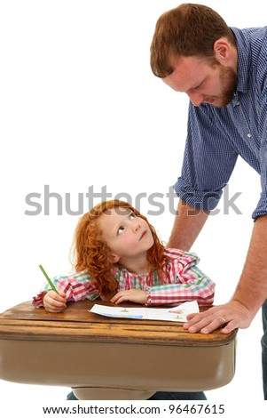 Teacher or Father Helping Elementary Student at Desk over White Background - stock photo