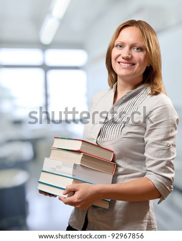 teacher or student holds the books - stock photo
