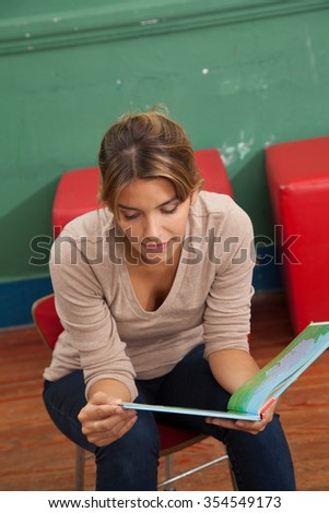Teacher reading a book