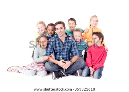 teacher reading stories to his students - stock photo
