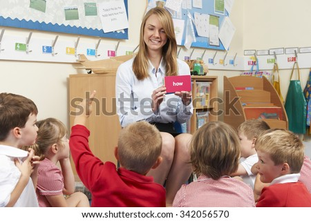 Teacher Showing Flash Cards To Elementary School Class - stock photo