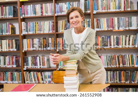 Teacher smiling at camera at library at elementary school