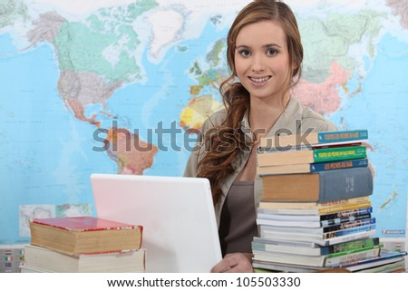 Teacher stood at front of classroom - stock photo