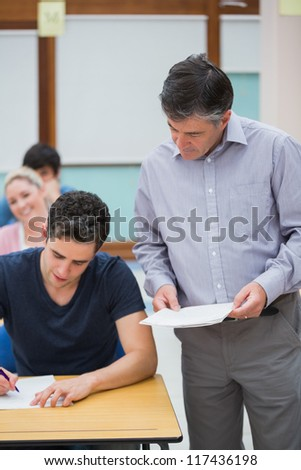 Teacher talks to a student at the classroom