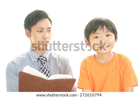 Teacher with boy studying. - stock photo