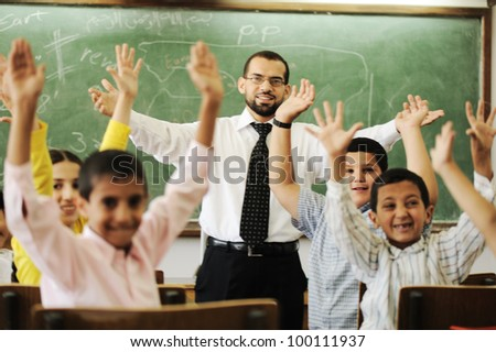 Teacher with boys and girls in school