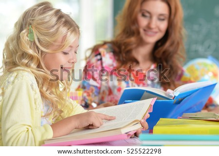 teacher with girl at lesson