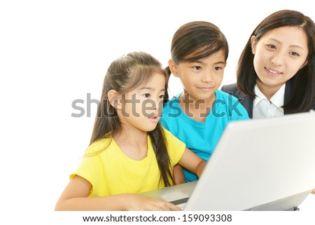 Teacher with girls studying. - stock photo