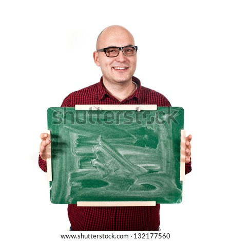 Teacher with glasses holding green chalkboard.