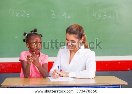 Teacher with multi ethnic classroom. Happiness and integration concept.