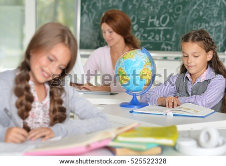 Teacher with two girls at lesson