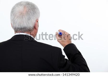 Teacher writing on white board - stock photo
