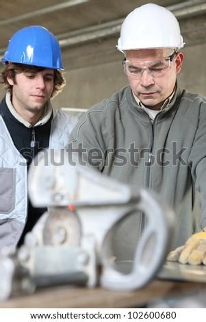 Teaching apprentice - stock photo
