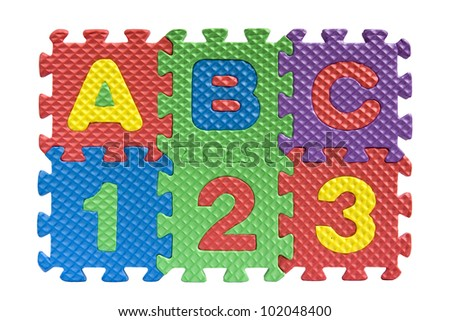 "Teaching kids concept - the letters ""ABC"" and numbers ""123"" spelled with alphabet puzzle pieces isolated on white background - stock photo"