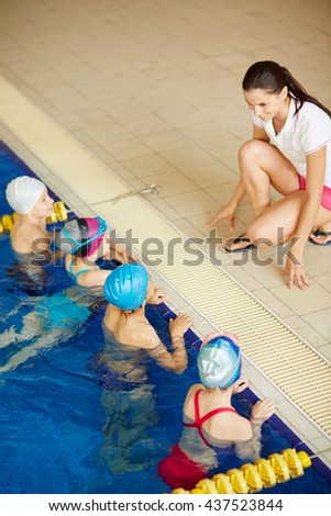 Teaching little swimmers - stock photo