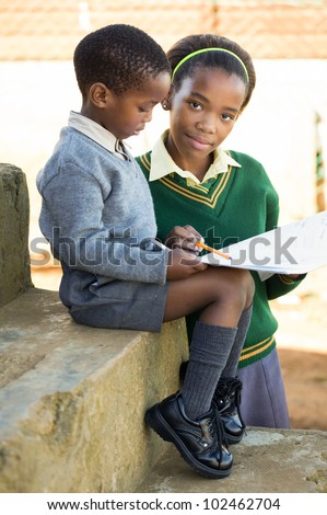 Teaching something to a smaller you, leaves the world a better place - stock photo