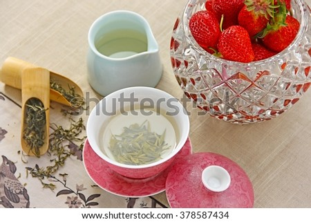 Teacup and strawberries food background. - stock photo