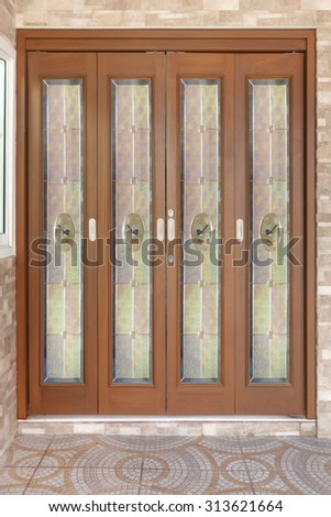 Teak wood door with glass. - Background. - stock photo
