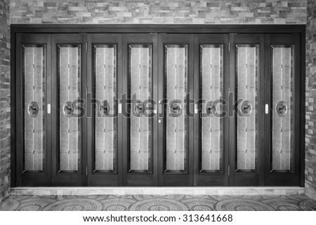 Teak wood door with glass. - ( Monochrome color style ) - stock photo