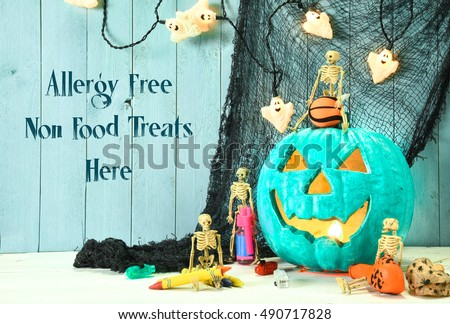 Teal pumpkin Jack O' Lantern indicates that this place provides allergy free non food treats for Halloween trick or treaters