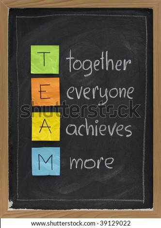 TEAM acronym (together everyone achieves more), teamwork motivation concept, color sticky notes, white chalk handwriting on blackboard - stock photo