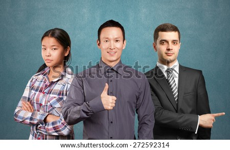 Team and male businessman in suit, looking on camera - stock photo