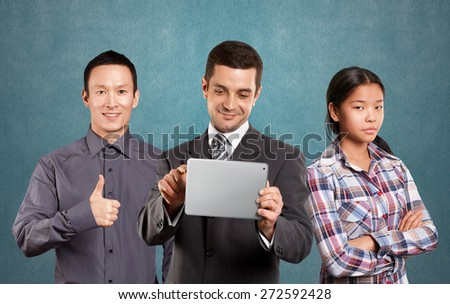 Team and man businessman in suit with touch pad in his hands - stock photo