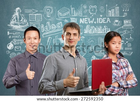 Team and man with laptop in his hands and woman shows well done - stock photo