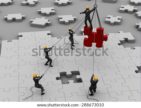 Team building a great jigsaw puzzle. A team building a great jigsaw puzzle project on the ground. - stock photo