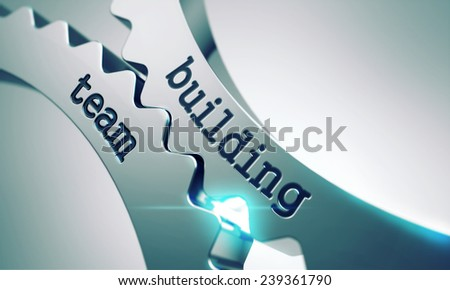 Team Building Concept on the Mechanism of Shiny Metal Cogwheels. - stock photo