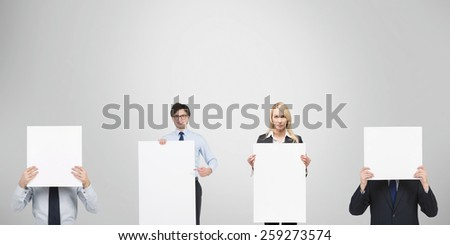 team businesspeople holding blank poster in hand - stock photo