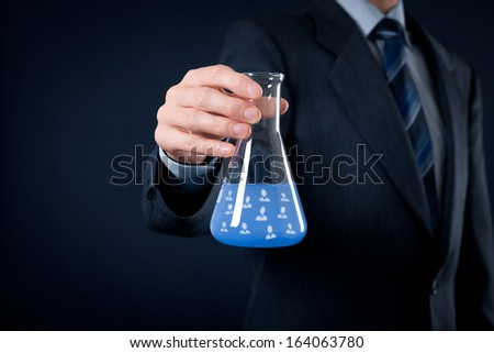Team composition and ideal team configuration recipe is science concepts. Human resources officer is mixing ideal team in laboratory glass.  - stock photo