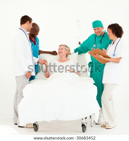 Team Doctors looking at a patient - stock photo