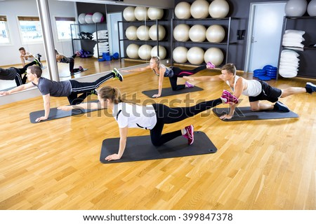 Team exercise core strength and balance at fitness gym - stock photo