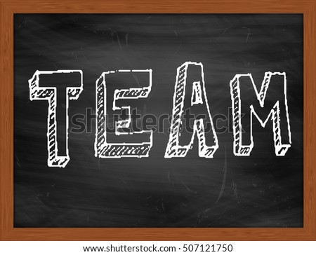 TEAM hand writing chalk text on black chalkboard